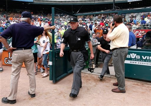 Home plate umpire Jim Joyce, ceter, takes the field before a baseball game between the Detroit Tigers and Cleveland Indians in Detroit Thursday, June 3, 2010.