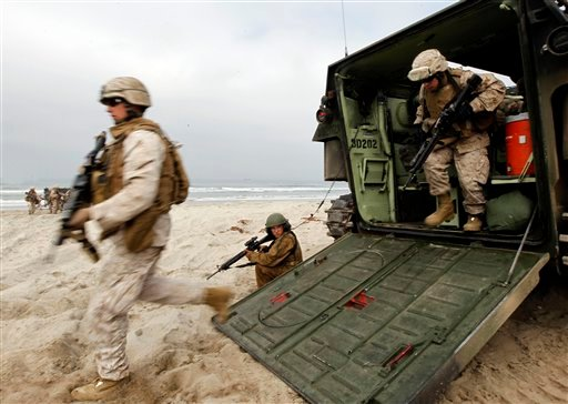"""Memebers of the U.S. Marines exit a amphibious assault vehicle after coming ashore during operation """"Dawn Blitz"""" at Camp Pendleton, Calif., Friday, June 4, 2010."""