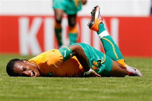 Ivory Coast forward Didier Drogba screams in pain after being injured during an international friendly test game between the national soccer teams of Ivory Coast and Japan. (AP Photo/Keystone, Jean-Christophe Bott)