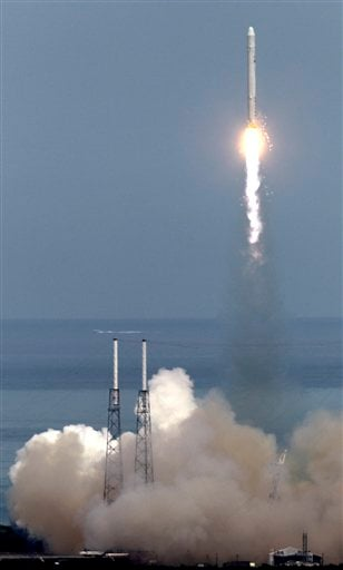 The SpaceX Falcon 9 test rocket lifts off from complex 40 at the Cape Canaveral Air Force Station in Cape Canaveral, Fla., Friday, June 4, 2010. The rocket is carrying a mock-up of the company's spacecraft, named Dragon.