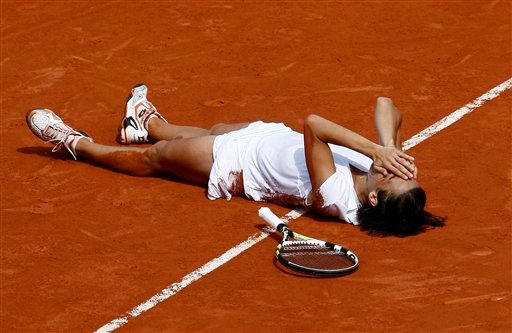 Italy's Francesca Schiavone lays on the clay after defeating Australia's Samantha Stosur during a women's final match for the French Open tennis tournament at the Roland Garros stadium in Paris, Saturday, June 5, 2010. (AP Photo/Michel Spingler)