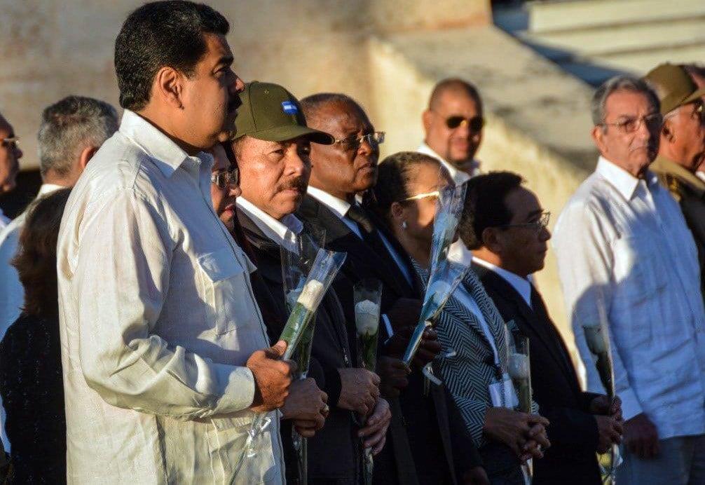 Venezuela's President Nicolas Maduro, left, Nicaragua's President Daniel Ortega attend the burial ceremony of the ashes of the late Fidel Castro at the Santa Ifigenia cemetery in Santiago, Cuba Dec.4, 2016.(Marcelino Vazquez Hernandez/Pool Photo via AP)