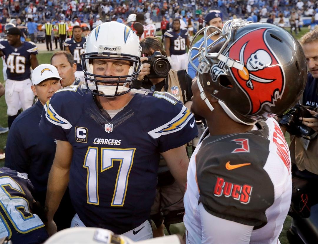 San Diego Chargers quarterback Philip Rivers, left, greets Tampa Bay Buccaneers quarterback Jameis Winston after their loss during an NFL football game Sunday, Dec. 4, 2016, in San Diego. (AP Photo/Gregory Bull)
