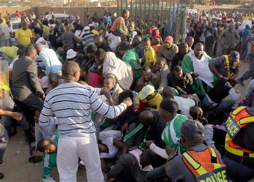 Fans fall on each other prior to the warmup match between North Korea and Nigeria in Johannesburg, South Africa, Sunday June 6, 2010.  (AP Photo/Frank Augstein)