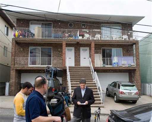 A television crew does a live broadcast outside the home of Mohamed Mahmood Alessa, who was arrested at JFK airport as he tried to board a plane bound for Egypt, Sunday, June 6, 2010 in North Bergen, N.J. (AP Photo/Joe Epstein)