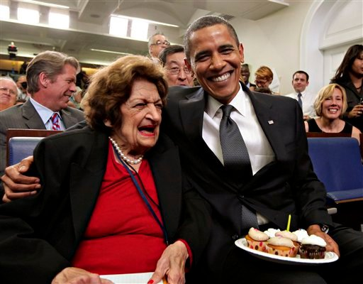 In this Aug. 4, 2009 file photo, President Barack Obama, marking his 48th birthday, takes a break from his official duties to bring birthday greetings to veteran White House reporter Helen Thomas, left, who shares the same birthday.