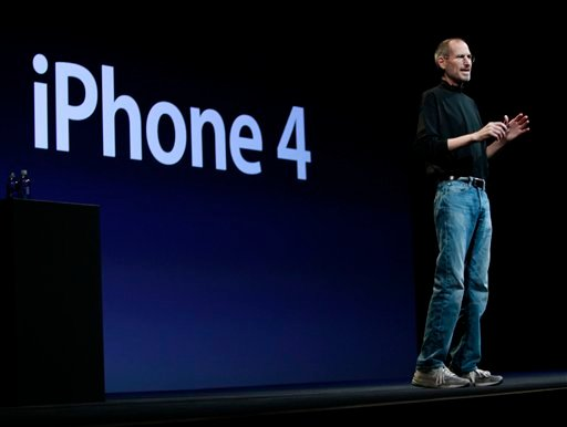 Apple CEO Steve Jobs introduces the new iPhone 4 at the Apple Worldwide Developers Conference, Monday, June 7, 2010, in San Francisco. (AP Photo/Paul Sakuma)