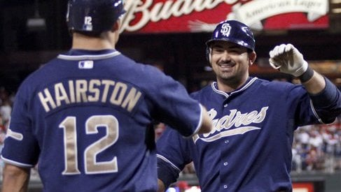 San Diego Padres' Adrian Gonzalez celebrates with Scott Hairston (12) after Gonzalez hit a solo home run against the Philadelphia Phillies in the ninth inning. (AP Photo/H. Rumph Jr)