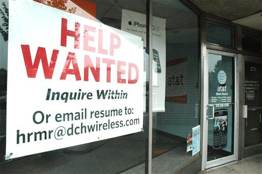 In this June 3, 2010 file photo, a help wanted sign fills a window at an at&t cell phone store in Rockville Centre, N.Y. (AP Photo/Rich Kareckas, file)