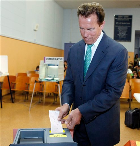 California Gov. Arnold Schwarzenegger sees that the ballot machine has rejected his ballot because he had voted for two Senate candidates, at a polling place at Kenter Canyon Elementary School in the Brentwood district of Los Angeles.
