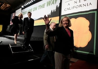 Meg Whitman, running for California's Republican gubernatorial candidate, waves as he walks off the stage during a walk-through before an election night gathering in Los Angeles, Tuesday, June 8, 2010.