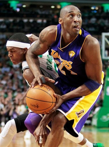 Los Angeles Lakers guard Kobe Bryant, right, drives past Boston Celtics guard Rajon Rondo during the second quarter in Game 3 of the NBA basketball finals Tuesday, June 8, 2010, in Boston. (AP Photo/Michael Dwyer)