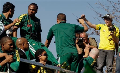 South African soccer players wave to their supporters during a street parade in Johannesburg, Wednesday, May June 9, 2010. South Africa will playing their Soccer World Cup group A opening match against Mexico on June 11. (AP Photo/Themba Hadebe)