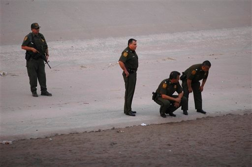 US border patrol agents examine the area near where 14 year-old Mexican citizen Sergio Adrian Hernandez Huereca was killed.