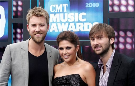 Dave Haywood, right, Hillary Scott, center and Charles Kelley of the group Lady Antebellum attend the 2010 CMT Awards in Nashville, Tenn. Wednesday, June 9, 2010. (AP Photo/Peter Kramer)