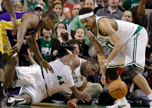 Los Angeles Lakers forward Ron Artest, left, and Boston Celtics forwards Glen Davis, center, and Rasheed Wallace, right, go after a loose ball during the fourth quarter in Game 4 of the NBA basketball finals Thursday, June 10, 2010, in Boston. (AP Photo)