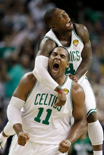 Boston Celtics forward Glen Davis (11) guard Nate Robinson, rear, celebrate a scoring run against the Los Angeles Lakers during the fourth quarter in Game 4 of the NBA basketball finals Thursday, June 10, 2010, in Boston. (AP Photo/Charles Krupa)