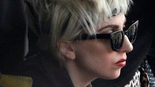 Lady Gaga  watches the ninth inning of the first game of a baseball doubleheader between the San Diego Padres and the New York Mets on Thursday, June 10, 2010 in New York. (AP Photo/Frank Franklin II)