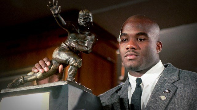 Colorado's Rashaan Salaam poses with the 1994 Heisman Trophy which he was awarded Saturday, Dec. 10, 1994, at the Downtown Athletic Club in New York. (AP Photo/Adam Nadel)