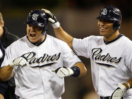 San Diego Padres' Nick Hundley, left, celebrates with Scott Hairston after his game winning sacrifice fly in the bottom of the ninth inning beat the Seattle Mariners 4-3 in a baseball game Friday, June 11, 2010, in San Diego. (AP Photo/Lenny Ignelzi)