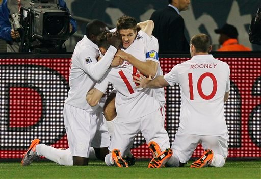 England's Steven Gerrard, center back, celebrates with England's James Milner, center front, England's Wayne Rooney, right, and England's Emile Heskey, left, after scoring the opening goal.