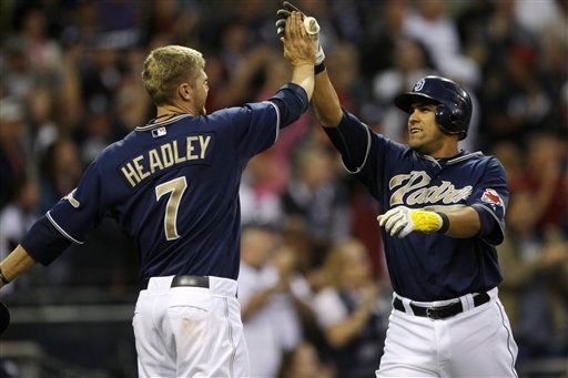 San Diego Padres' Oscar Salazar, right, is congratulated by Chase Headley after his three-run pinch hit home run in the eighth inning of the Padres 7-1 victory over the Seattle Mariners in a baseball game Saturday, June 12, 2010. (AP Photo/Lenny Ignelzi)