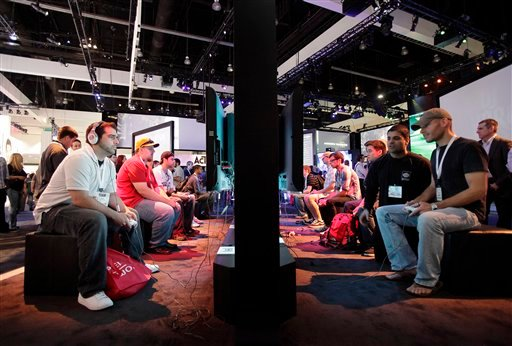 In this June 2, 2009 file photo, show attendees play video games at the Activision booth at the E3 Expo in Los Angeles. (AP Photo/Jae C. Hong, file)