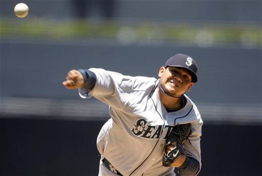 Seattle Mariners starter Felix Hernandez pitches in the first inning against the San Diego Padres in a baseball game Sunday June 13, 2010. (AP Photo/Lenny Ignelzi)