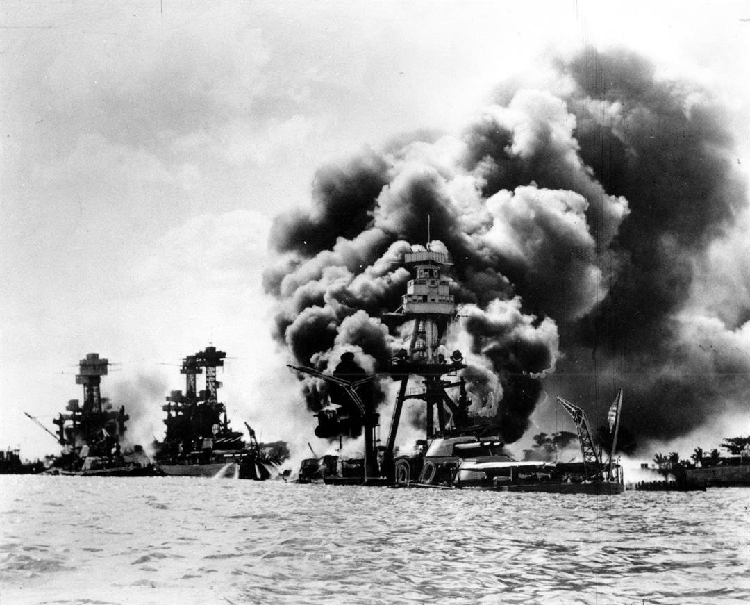 Japan's bombing of U.S. military bases at Pearl Harbor brings the U.S. into World War II. From left are: USS West Virginia, severely damaged; USS Tennessee, damaged; and USS Arizona, sunk. (AP Photo)