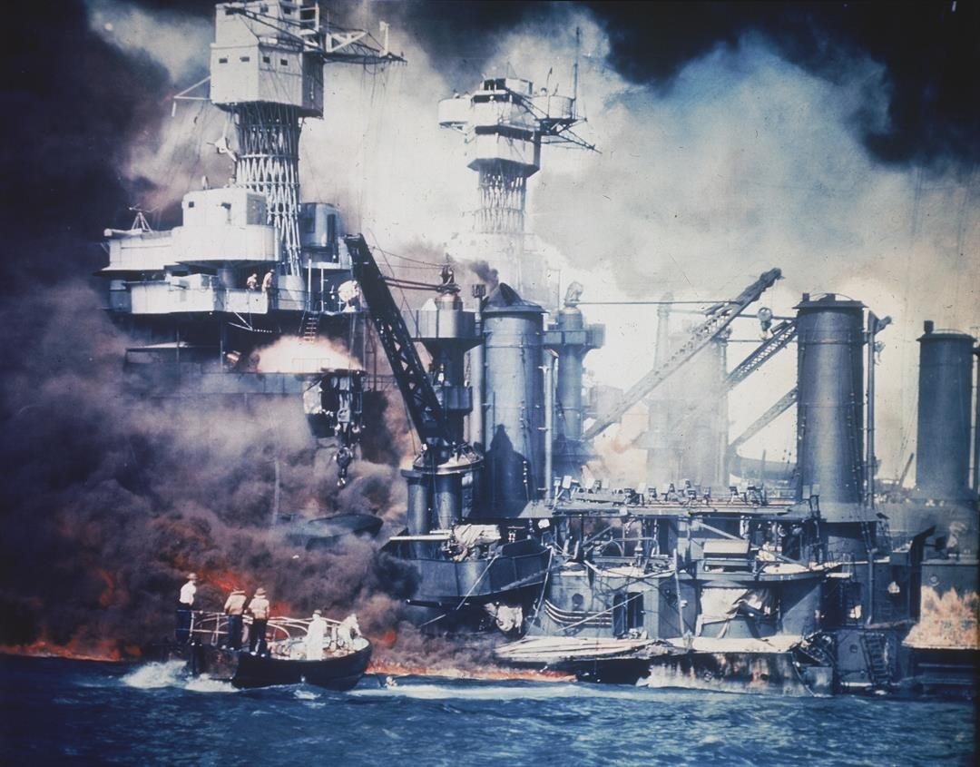 A small boat rescues a USS West Virginia crew member from the water after the Japanese bombing of Pearl Harbor, Hawaii on Dec. 7, 1941 during World War II. AP