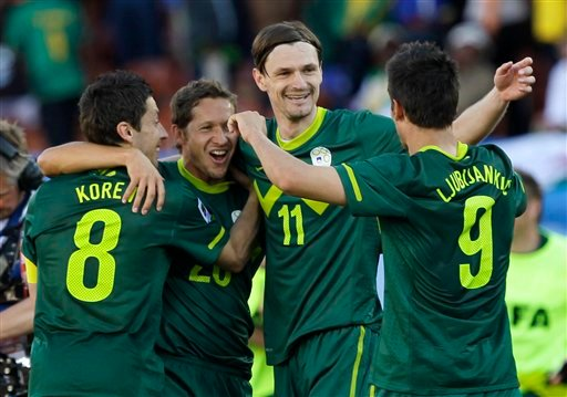 Slovenia's Robert Koren, left, celebrates with his teammates Zlatan Ljubijankic, right, Milivoje Novakovic, second from right, and Andrej Komac, second left, after scoring the winning goal during the World Cup group C soccer match.