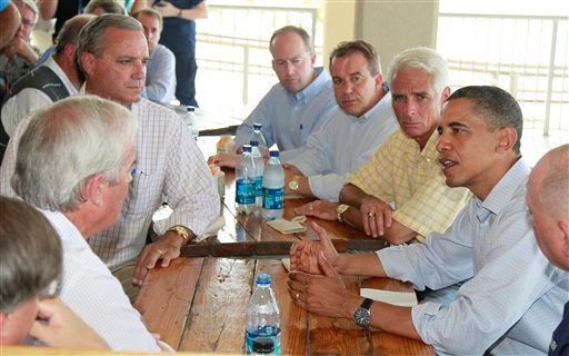 President Barack Obama, flanked by Florida Gov. Charlie Crist, left, National Incident Commander Adm. Thad Allen, right, makes a statement on Pensacola Beach, Fla., Tuesday, June 15, 2010, as they visited the Gulf Coast.