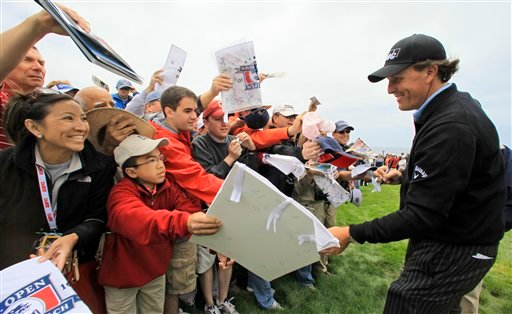 Phil Mickelson signs autographs for fans during a practice round for the U.S. Open golf tournament Tuesday, June 15, 2010, at the Pebble Beach Golf Links in Pebble Beach, Calif. (AP Photo/Charlie Riedel)