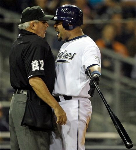 Home plate umpire Larry Vanover and San Diego Padres Yorvit Torrealba argue after Torrealba was called out on strikes in the ninth inning of the Padres 6-3 loss to the Toronto Blue Jays in a baseball game Monday June 14, 2010 In San Diego, Calif.