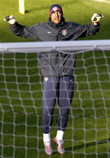 U.S. national soccer goalkeeper Tim Howard jumps to loosen up during training at Pilditch Stadium in Pretoria, South Africa Tuesday, June 15, 2010.