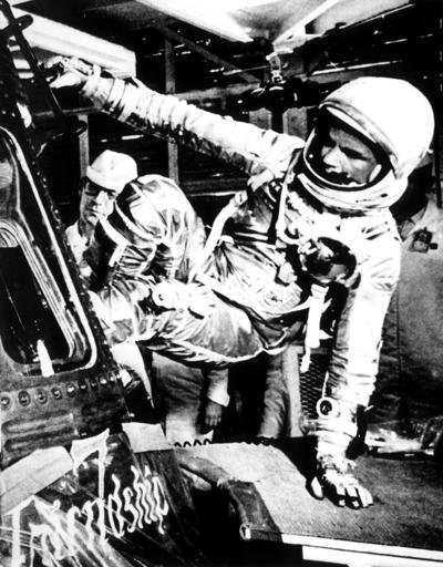 In this Feb. 20, 1962, file photo, U.S. astronaut John Glenn climbs inside the capsule of the Mercury spacecraft Friendship 7 before becoming the first American to orbit the Earth, at Cape Canaveral Air Force Station in Cape Canaveral, Fla.