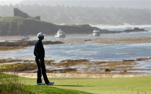 Tiger Woods waits to putt on the 18th hole during a practice round for the U.S. Open golf tournament Wednesday, June 16, 2010, at the Pebble Beach Golf Links in Pebble Beach, Calif. (AP Photo/Charlie Riedel)