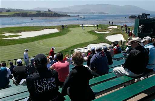Fans on the 17th hole watch a practice round for the U.S. Open  golf tournament Wednesday, June 16, 2010, at the Pebble Beach Golf Links in Pebble Beach, Calif. (AP Photo/Eric Risberg)