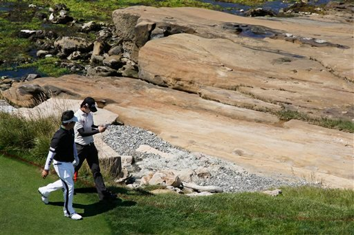 Seung Yul Noh, right, and Y.E. Yang of Korea walk up the 18th hole during a practice round for the U.S. Open golf tournament Wednesday, June 16, 2010, at the Pebble Beach Golf Links in Pebble Beach, Calif. (AP Photo/Eric Risberg)