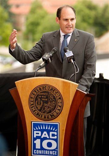 In this photo taken June 11, 2010, Pac-10 commissioner Larry Scott talks about Colorado joining the Pac-10 during ceremonies at the University of Colorado in Boulder, Colo.