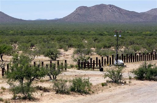 In this May 13, 2010 photo, a new border fence designed to stop vehicle traffic runs along the U.S.-Mexico border at the point of entry in San Miguel, Ariz. (AP Photo/Ross D. Franklin)