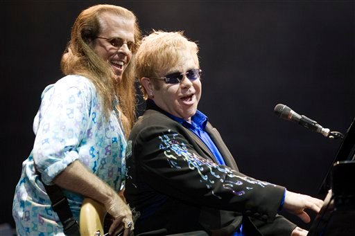 British singer and songwriter Sir Elton John, right, and guitar player Bob Birch perform in a concert at the Ramat Gan stadium near Tel Aviv, Israel, Thursday, June 17, 2010.