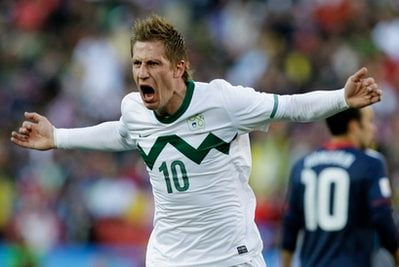 Slovenia's Valter Birsa celebrates after scoring the opening goal during the World Cup group C soccer match between Slovenia and the United States at Ellis Park Stadium in Johannesburg, South Africa, Friday, June 18, 2010.
