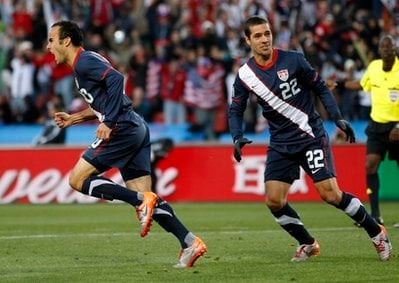 United States' Landon Donovan, left, celebrates after scoring during the World Cup group C soccer match between Slovenia and the United States at Ellis Park Stadium in Johannesburg, South Africa, Friday, June 18, 2010.