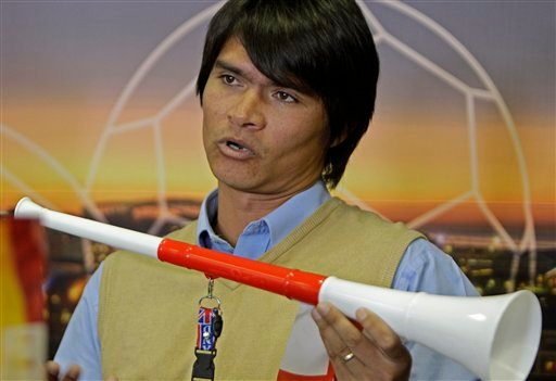 Inventor Neil van Schalkwyk holds a vuvuzela during a press conference at Cape Town, South Africa, Monday, June 18, 2010. Neil van Schalkwy'sk company manufactures vuvuzelas used during the Soccer World Cup in South Africa. (AP Photo/Schalk van Zuydam)