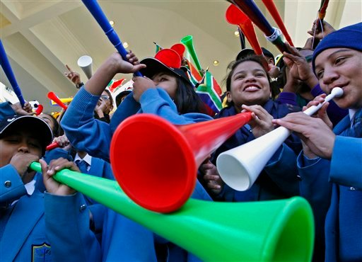 South Africans blow their vuvuzela as they gather to show their support for the South African team in the city center of Cape Town, South Africa, Wednesday, June 9, 2010. The World Cup will kick off on June 11. (AP Photo/Schalk van Zuydam)
