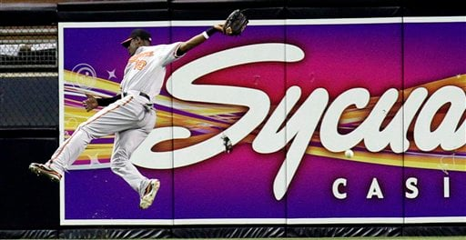 Baltimore Orioles' Adam Jones misses the catch on a hit from San Diego Padres' Adrian Gonzalez during their baseball game Friday, June 18, 2010 in San Diego. (AP Photo/Gregory Bull)