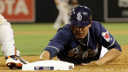 San Diego Padres' Will Venable reaches back to first while playing the Baltimore Orioles during their baseball game Friday, June 18, 2010 in San Diego. (AP Photo/Gregory Bull)