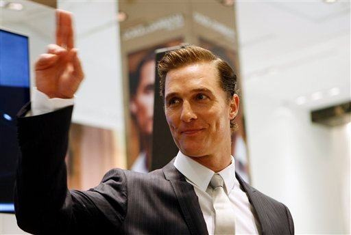 US actor Matthew McConaughey, gestures, during a promotional event to launch a scent by Italian designers Dolce and Gabbana, in Milan, Italy, Friday, June 18, 2010. (AP Photo/Antonio Calanni)