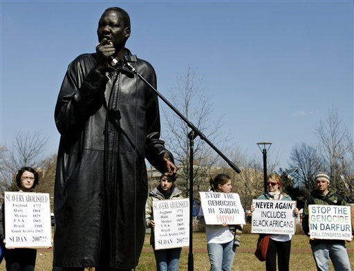 In this March 23, 2006 photo former NBA star Manute Bol speaks at a rally at the Independence Visitor Center as part of the Philadelphia stop of the Sudan Freedom Walk, a 300-mile march from New York to Washington. (AP Photo/Matt Rourke)